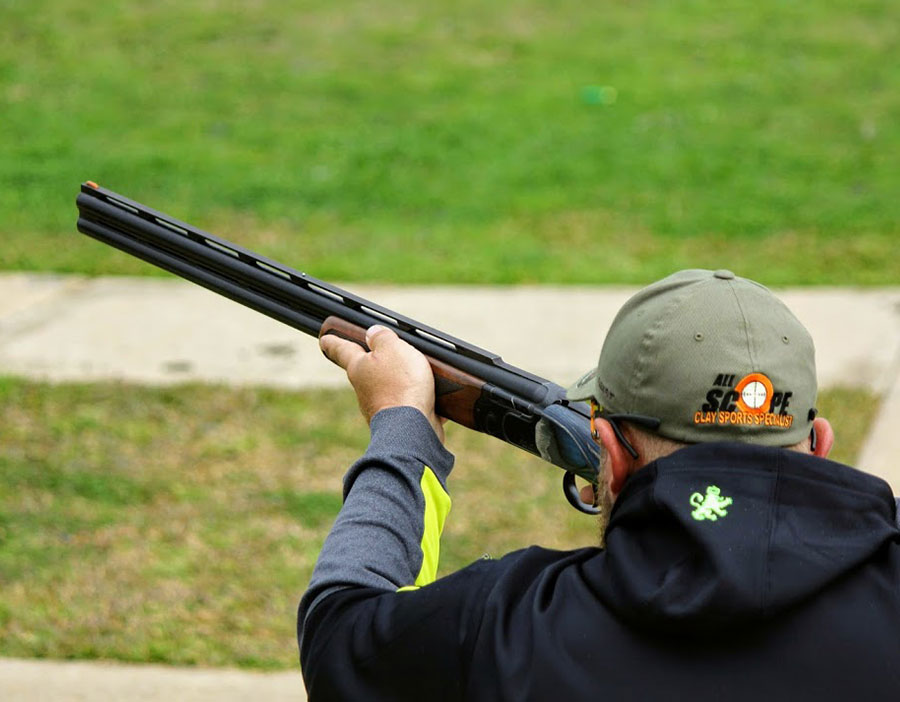 Queensland clay target shooting - shooter setting up to take aim