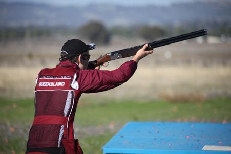 queensland clay target association - man shooting targets with shotgun